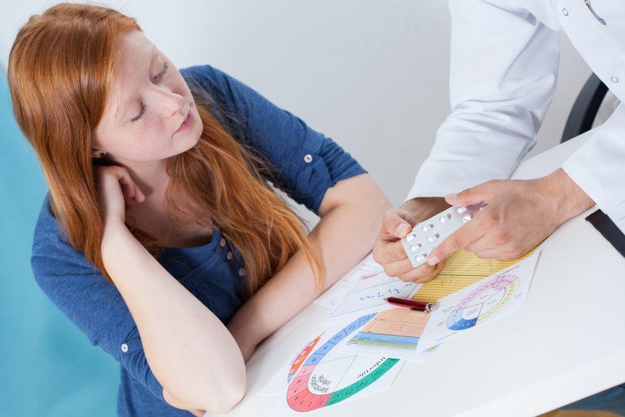женщина на приеме гинеколога